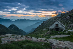 Mountain refuge. Refuge on mountain alps at sunset or sunrise Royalty Free Stock Photos