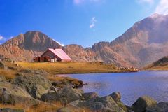 Mountain refuge next to a glacial lake in national park Pirin stock photos