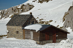 Mountain refuge on the snow slope Stock Image