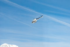 Mountain rescue emergency helicopter in flight, blue white Stock Photos