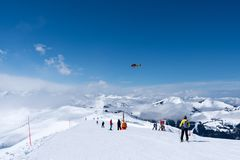 Mountain rescue helicopter above Alps, Kitzbuhel, Austria. Europe stock images