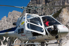 Mountain rescue helicopter in the italian Alps Stock Photos