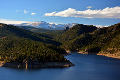 Mountain Reservoir with Snow Covered Peaks Stock Image