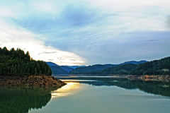 Mountain Reservoir at Sundown HDR. The sun going down reflected on the beautiful Hills Creek mountain reservoir in Oregon royalty free stock photography