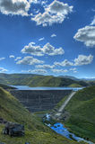 Mountain reservoir wall. The famous Mohale Dam in Lesotho, with its earth-fill wall, spills into the Little Orange river (Senqunyana Stock Images
