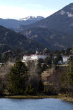 Mountain Resort. An historic hotel is seen across the lake at a mountain resort Royalty Free Stock Photography