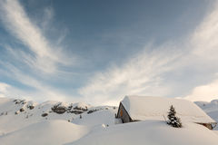 Mountain resort covered in snow. Mountain house covered in meters of snow Royalty Free Stock Photography