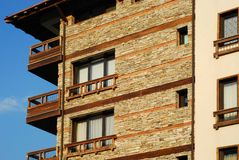 Mountain resort hotel. Stonewall, wooden details close-up stock image