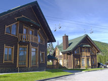 Mountain resort wooden hotel cottages Stock Photography
