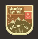Mountain retro logo and emblem with campfire and axes. Can be us vector illustration