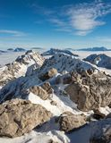 Mountain ridge above the clouds. Mountain chain above the clouds Stock Photo