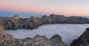 Mountain ridge above clouds Royalty Free Stock Images