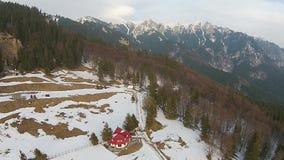 Mountain ridge aerial panning stock footage