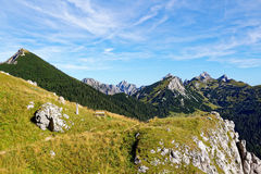 Alpine hiking trail on mountain ridge summer scenery. Hike on the mountain top. View over the mountain tops of the Allgäu Alps, Europe, with long-distance Royalty Free Stock Photo