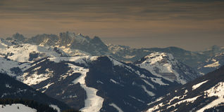 Mountain ridge in Austrian Alps in late evening. Mountain ridge in winter in Austrian Alps in late evening light in a sky resort (Zell am See Stock Images