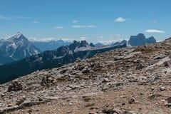 Mountain Ridge with Big Stone among Barren Mountains in Italian Stock Photo