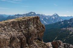 Mountain Ridge with Big Stone among Barren Mountains in Italian Stock Photography
