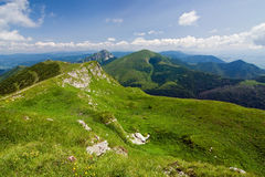 Mountain-ridge and blue sky with clouds Stock Image