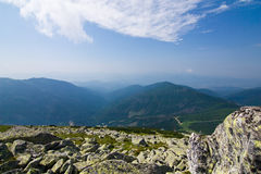 Mountain ridge and blue sky with clouds Stock Photography