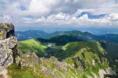 Mountain ridge and blue sky with clouds Stock Images