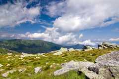 Mountain ridge and blue sky with clouds Royalty Free Stock Photo