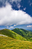 Mountain ridge and blue sky with clouds Royalty Free Stock Image