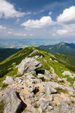 Mountain ridge and blue sky with clouds Royalty Free Stock Photography