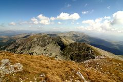Mountain ridge and clouds royalty free stock image