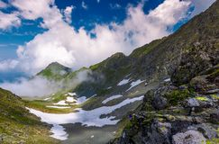 Mountain ridge among the clouds. Beautiful summer landscape with peak in the far distance Stock Photography