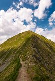 Mountain ridge on a cloudy day. Beautiful nature summer scenery in Fagaras mountains, Romania. concept of outdoor activity in any weather condition. lovely Stock Images