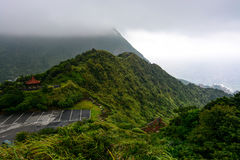 Mountain ridge on the coast of Taiwan with Mount Keelung disappearing into the clouds in the background Stock Photography