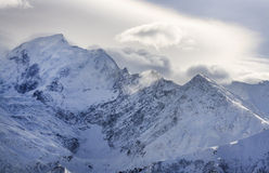 Mountain ridge covered by clouds Stock Images