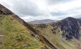 Mountain ridge in Dingle peninsula. Ridge and summit of the Slievenagower mountain, located close to the village of Cloghane, Dingle peninsula, co Kerry, Ireland Stock Photos