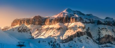 Mountain and ridge of Dolomiti covered with snow. Mountain snow landscape and ridge of Dolomiti with sunlight on summit, Italy royalty free stock photo