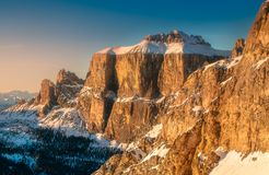 Mountain and ridge of Dolomiti covered with snow. Mountain snow landscape and ridge of Dolomiti with sunlight on summit, Italy stock photos