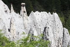 Mountain ridge with earth pyramids in the french Hautes-Alpes royalty free stock photography