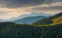 Mountain ridge with forest on hills at sunrise Royalty Free Stock Photos