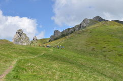 Mountain ridge and hikers Stock Photo