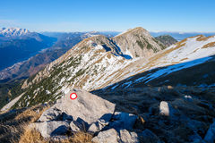 Mountain ridge with hiking mark in the foreground Royalty Free Stock Photos