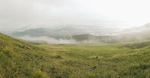 Mountain Ridge. Hitting a cold good morning to the peaceful meadows of Kapayawan ridge, taken at Bukidnon, Davao City.  Fogs/clouds lies beyond the ridge makes Stock Image