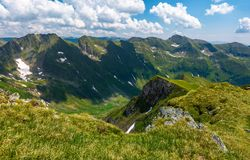 Mountain ridge observed from the opposite cliff. Gorgeous summer landscape in Fagarasan mountains of Romania Royalty Free Stock Image