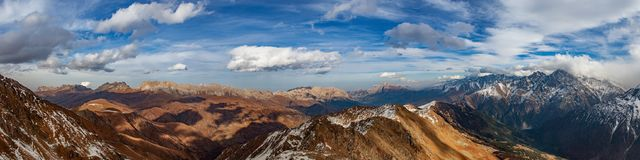 Mountain ridge, panorama, Caucasus, Russia. Panorama made on the top of the ridge. See all Rocky ridge and the Lateral ridge Royalty Free Stock Images