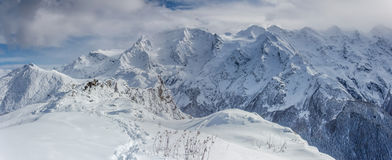 Mountain ridge. Panoramic view on mountains in winter Stock Images