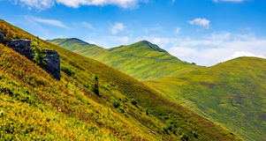 Mountain ridge with peak behind the hillside. Beautiful summer background Royalty Free Stock Photography