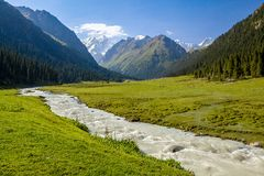 Mountain ridge and rapid river. Tien Shan royalty free stock photography
