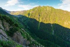 Mountain ridge with rocky cliffs and grassy slopes. Beautiful nature scenery of Fagaras mountains, Romania royalty free stock photo
