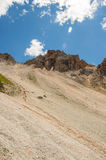 Mountain ridge with scree bellow. Mountain slope with scree underneath it Stock Photo