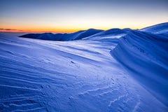 Mountain Ridge sunset. Crusty ice mountain ridge at twilight Royalty Free Stock Image