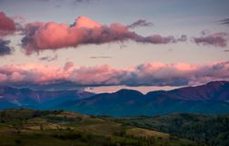 Mountain ridge under the pink sky at dawn Royalty Free Stock Photography