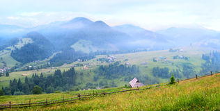 Mountain ridge and village view Stock Images
